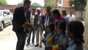 Honorable Peter Budd, Ambassador of Australia receiving bunch of flower from panchakanya at school premises