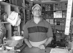 A man with physical disability who is busy in his shop