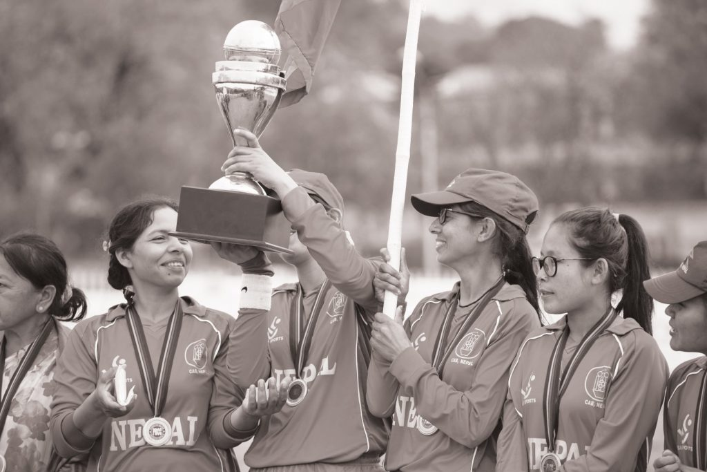 nepali players holding the trophy after winning the tournament