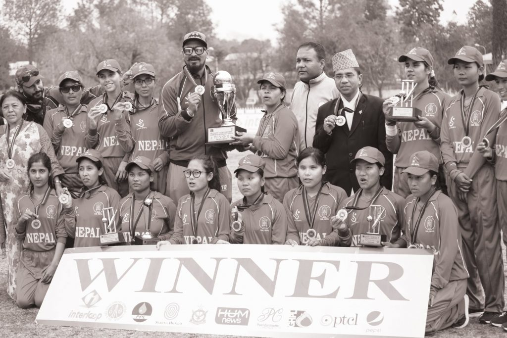 The group photo of Nepali team after they won the tournament. They are seen with trophy and winner banner