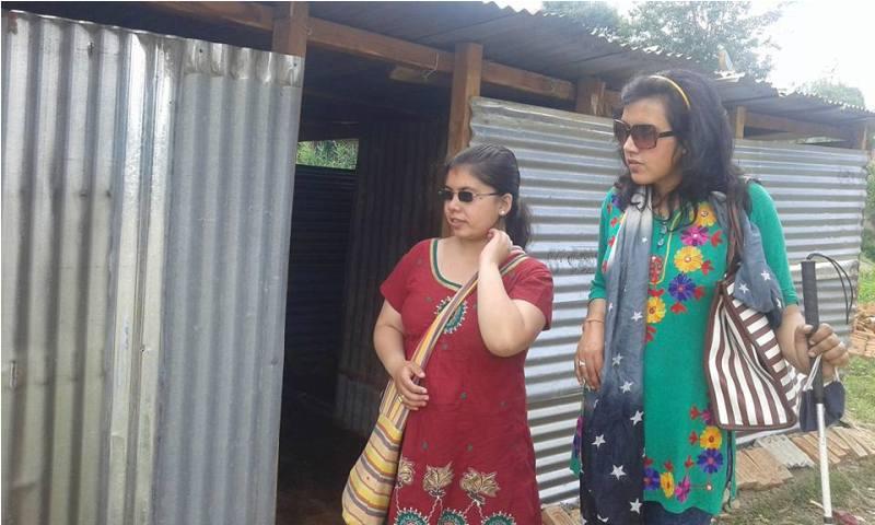 Sarita Lamichhane distributing releif