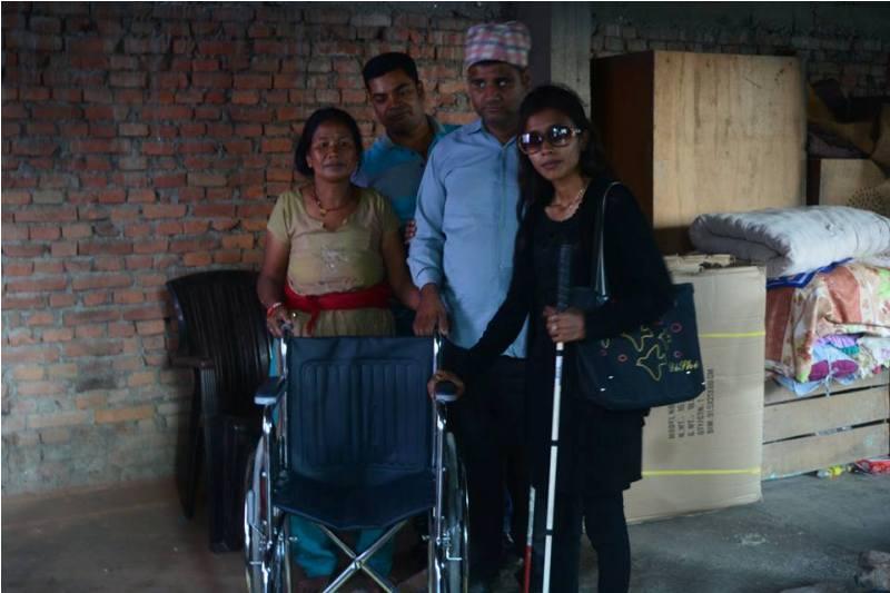 Shristi KC donating wheelchair
