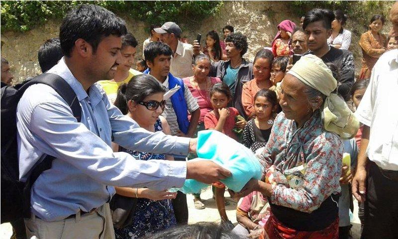Sushil Adhikari distributing releif