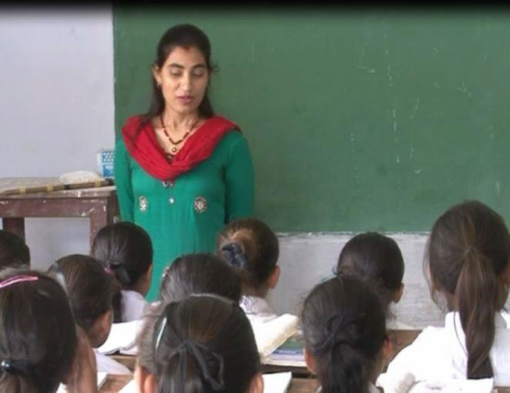 a teacher teaching in her class