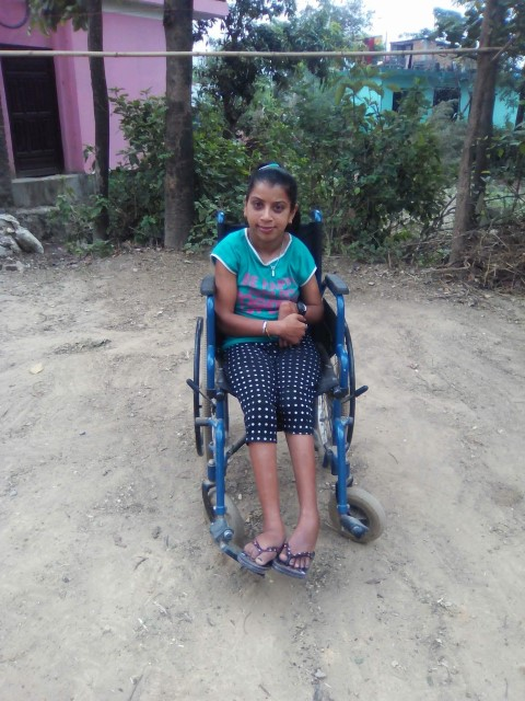 Sita Regmi in her wheelchair
