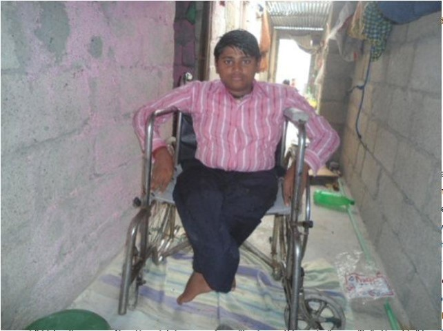 a small child in a wheelchair