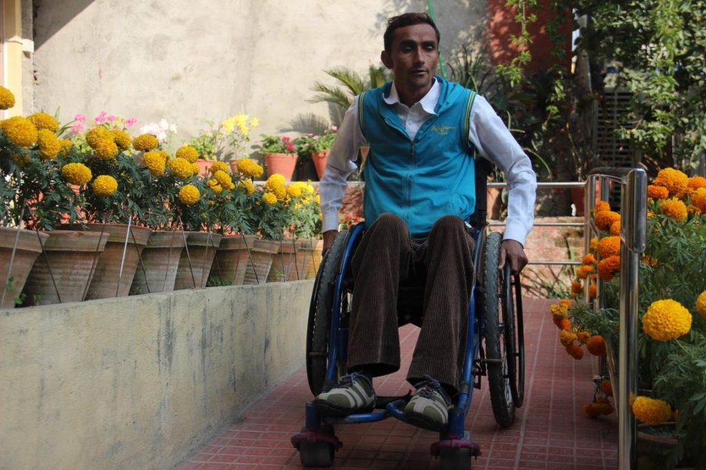 a man using wheelchair wheeling down the ramp
