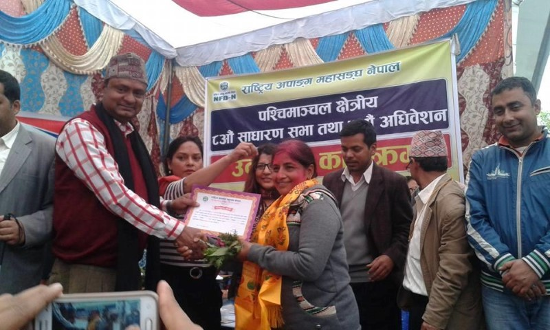 NFDN president giving certificate of winning to Newly elected regional president Ms. Kalpana Dhakal