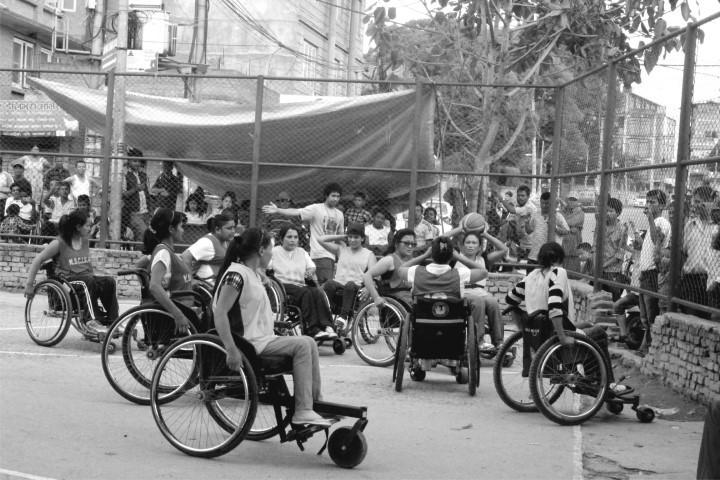 women using wheelchairs playing basket ball