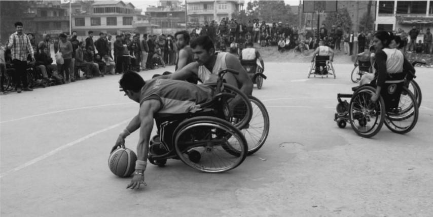Men using wheelchair playing Basketball